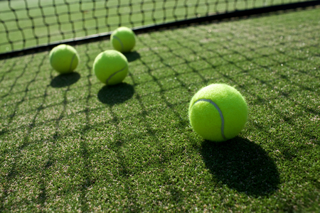 tennis balls on tennis grass court Stock Photo