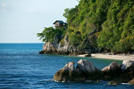 tropical birds: a hut on tropical birds nest island