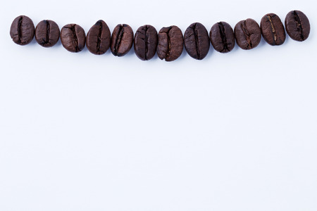 nicotine: effect from nicotine concept, coffee bean in the form of tooth. Part of a tooth health series Stock Photo
