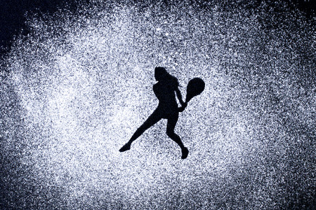 sport concept, shape of woman in action by powder. Part of a tennis series Stock Photo