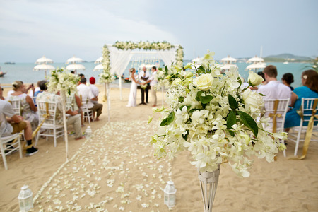 wedding beach: soft focus of beautiful flower decoration in the beach wedding ceremony Stock Photo