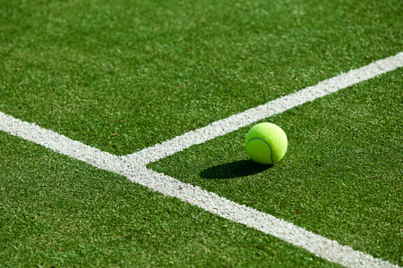 tennis ball on tennis grass court