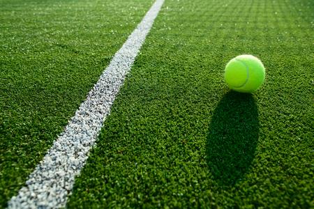 soft focus of tennis ball on tennis grass court good for background