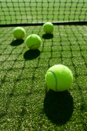 selective focus. tennis ball back light shadow on tennis grass court good for background Stock Photo