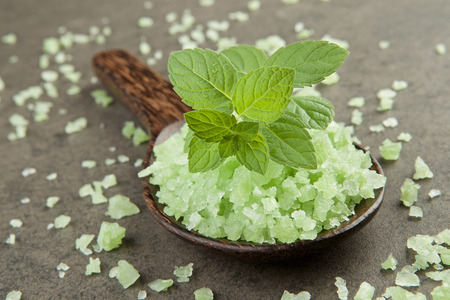 aromatherapy salt spa. peppermint on green salt spa in wooden spoon