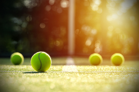 Tennis balls on grass court with sunlight Stock fotó