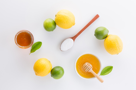 Homemade yogurt with honey and lemon on white background from top view. Flat lay