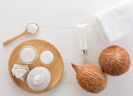 Homemade coconut products on white wooden table background from top view. Good for space and background.