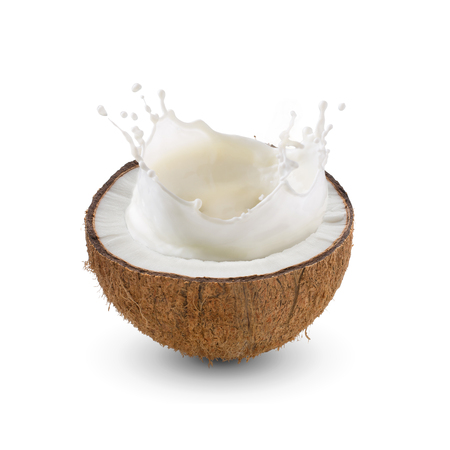 Cracked half of tropical fruit, Coconut with milk splash on white background