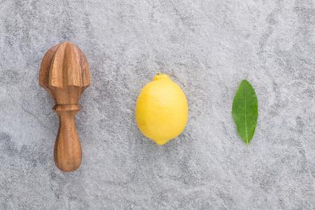 Fresh lemon with citrus juicer stick.