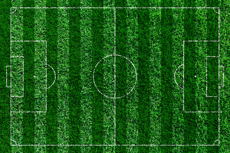Green football field, soccor field from top view.