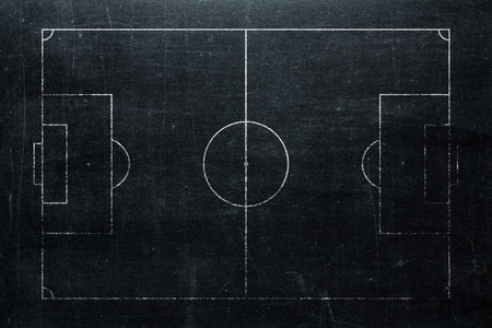 Football or soccer field isolated on blackboard texture with chalk rubbed Standard-Bild