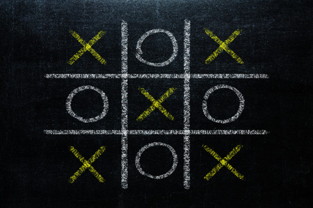 Abstract Tic Tac Toe Game Competition. XO Win Challenge Concept on black board 写真素材