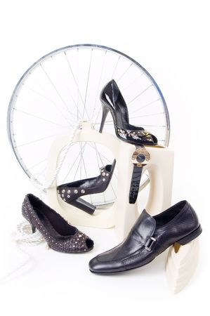 Conceptual still-life with shoes and wheel isolated on white Stock Photo - 2925628