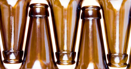 Close-up of beer bottles isolated on white background