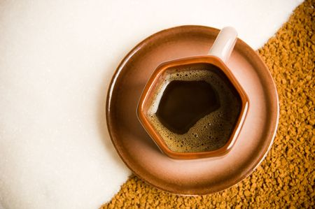 coffee grounds: Cup of coffee on coffee grounds at the table