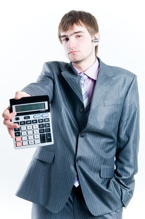 Tired businessman with calculator, isolated on white background photo