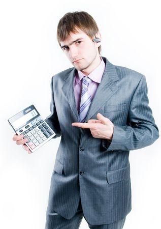 Upset businessman with calculator, isolated on white background photo