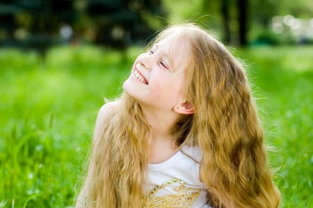 Smiling little girl in green grass