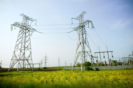 Electrical towers structure on blue sky background Stock Photo