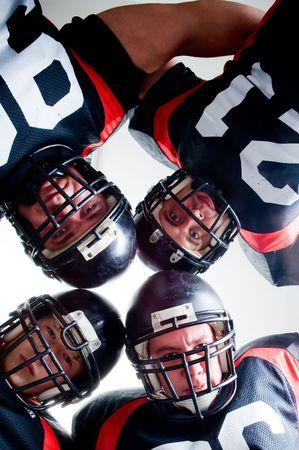 American football players, studio isolated  Stock Photo
