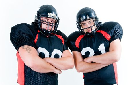 Two American football players isolated on white background Stock Photo