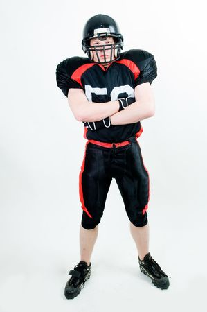 American football player in helmet, isolated on white background