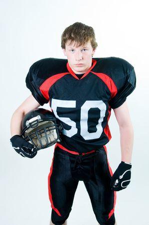 Joueur de football américain tenue casque, isolé sur fond blanc  Banque d'images