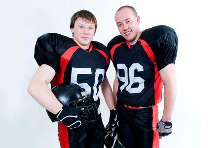 白い背景上に分離されて 2 人の若いアメリカン ・ フットボール プレーヤー