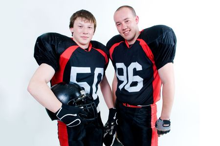 Two young American football players isolated on white background