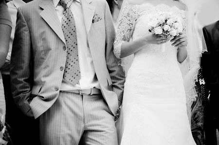 Close-up of bride and groom waiting for the ceremony, grayscale  Stock Photo