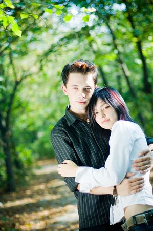 Young people hugging outdoors photo