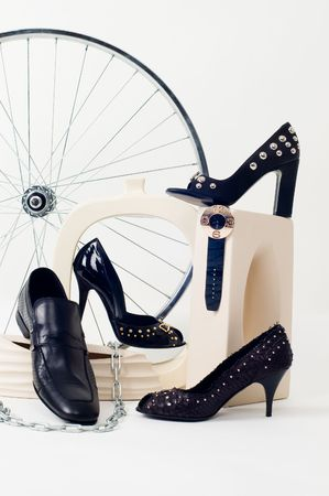 Conceptual still-life with shoes and wheel isolated on white Stock Photo - 3632251