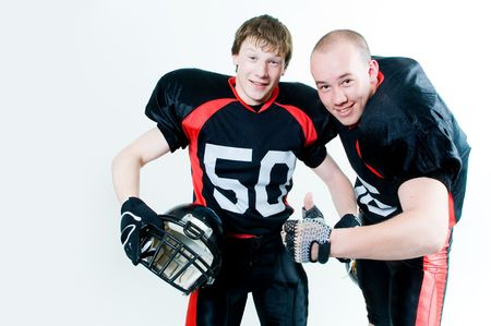Two friendly young American football players photo