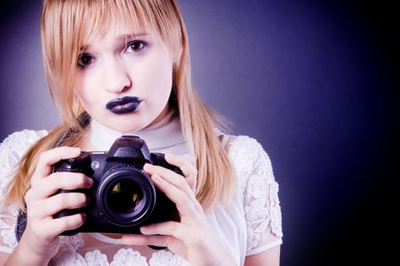 Young girl with digital camera photo