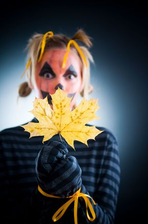 Halloween girl with tied hands, focus on leaf  photo