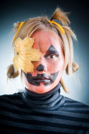 Jack-o-lantern girl with leaf on face photo