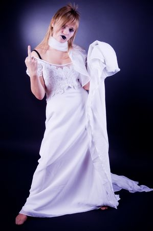 gesticulating: Young girl in wedding dress gesticulating, studio isolated