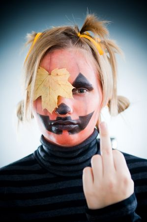 Upset Jack-o-lantern girl with leaf on face photo