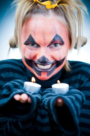 Halloween girl with candles, focus on face