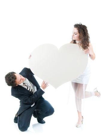 Young couple holding heart shape, isolated on white background  Stock Photo - 3767840