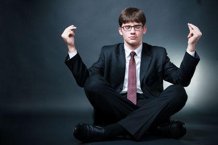 Business yoga, isolated on black background