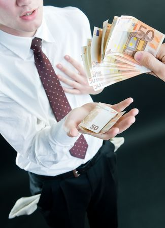 Businessman receiving money, isolated on black background  photo