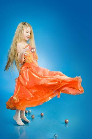 Cute little girl with holiday decorations, studio shot
