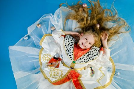 Smiling little girl in royal clothes, high angle of view photo