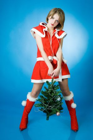 mrs santa claus: Young girl in Santa Claus clothes over blue background