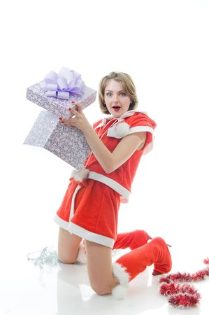 Surprised young girl in Santa Claus clothes with gift box  photo