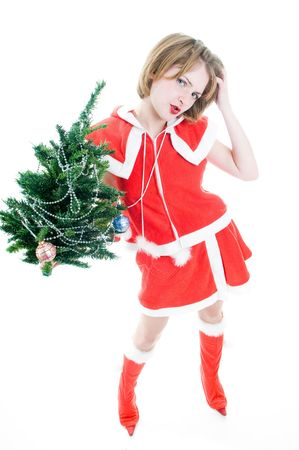 Funny mrs. Santa with Christmas tree, high angle of view  photo