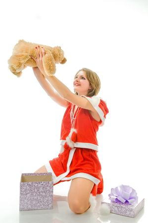 Smiling mrs. Santa with gift, isolated on white background  photo