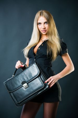 secretary skirt: Sexy businesswoman with leather suitcase, studio shot